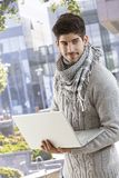 Young man using laptop computer outdoors Royalty Free Stock Images