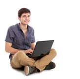 Young man using laptop computer Stock Photo