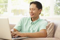 Young Man Using Laptop At Home Royalty Free Stock Photos