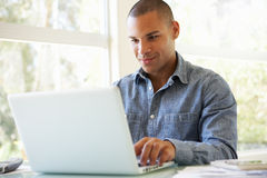 Young Man Using Laptop At Home Stock Photo