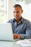 Young Man Using Laptop At Home Stock Image