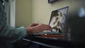Young man using laptop at home. Browser page on laptop screen. Young man using laptop at home. Freelancer working at home. Browser page on laptop screen stock footage