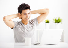 Young man using laptop in living room Royalty Free Stock Image
