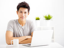 Young man using laptop in living room Stock Photos