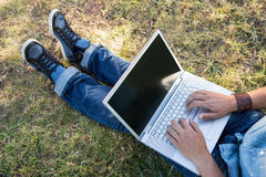 Young man using laptop in the park Royalty Free Stock Image