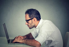 Young man using a laptop Stock Photography