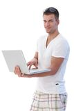 Young man using laptop smiling Stock Photos