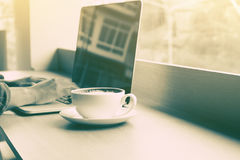 Young man using laptop with wifi connection and drink coffee at Royalty Free Stock Image