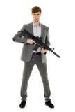 Young man using machine gun Royalty Free Stock Images
