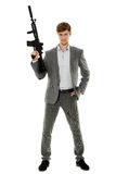 Young man using machine gun. Handsome businessman with machine gun isolated on white stock image