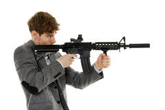 Young man using machine gun Stock Image