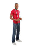 Young man using measuring tape Stock Photo