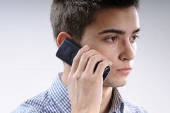 Young man using mobile Stock Photo