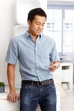 Young man using mobile. Phone, dialing or texting Royalty Free Stock Image
