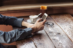Young man using a mobile phone at the bar Royalty Free Stock Images