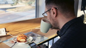 Young Man using Mobile Phone at Coffee stock footage