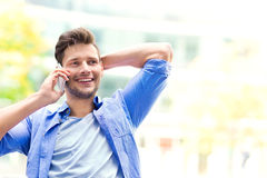 Young man using mobile phone outdoors Royalty Free Stock Images