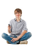 Young man using mobile phone for sms Royalty Free Stock Photos
