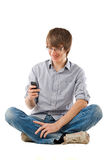 Young man using mobile phone for sms Stock Photography