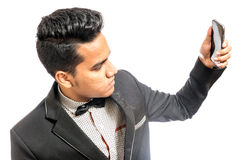 Young man using mobile phone. In white background Royalty Free Stock Photo