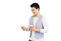 Young man using mobile phone Stock Image