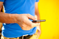 Young man using mobile smart phone Royalty Free Stock Photography