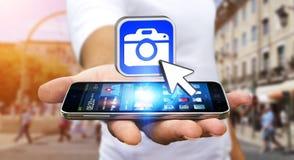 Young man using modern camera application Royalty Free Stock Image