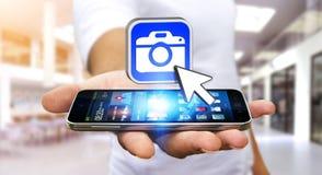 Young man using modern camera application Royalty Free Stock Photos