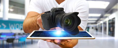 Young man using modern camera Royalty Free Stock Photography