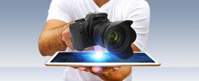 Young man using modern camera Stock Image
