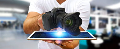 Young man using modern camera Royalty Free Stock Images