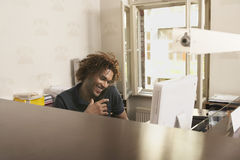 Young man Using Phone In Office Royalty Free Stock Photo