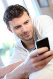 Young man using phone sending message Stock Photography