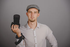 Young man using a professional camera Stock Photo