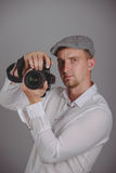 Young man using a professional camera Royalty Free Stock Image