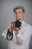 Young man using a professional camera Stock Image