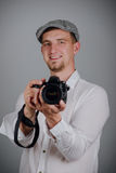 Young man using a professional camera Stock Photos