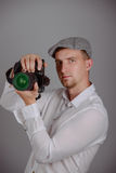 Young man using a professional camera Royalty Free Stock Photos