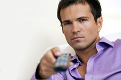 Young man using remote control Stock Photography