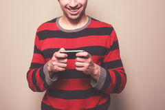 Young man using smart phone Stock Image