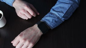 Young man using a smart watch stock video footage