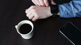 Young man using a smart watch stock video