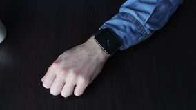 Young man using a smart watch stock footage