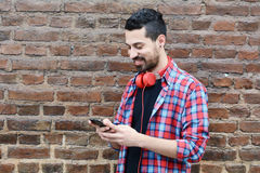 Young man using a smartphone. Royalty Free Stock Image