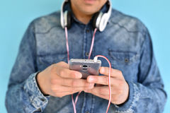 Young man using smartphone Stock Images