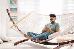 Free Young Man Using Smartphone In Hammock Stock Images - 170516824