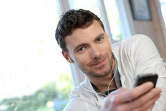 Young man using smartphone Royalty Free Stock Image