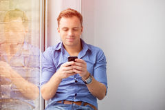 Young man using smartphone Stock Photo