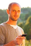 young man using smartphone outdoor Stock Photo