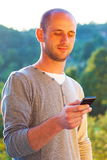 Young man using smartphone outdoor Royalty Free Stock Photo